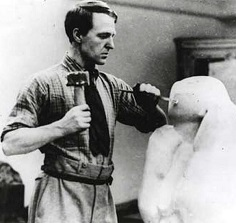 Henry Moore carving in stone